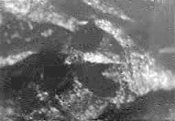 black and white image of titan's surface